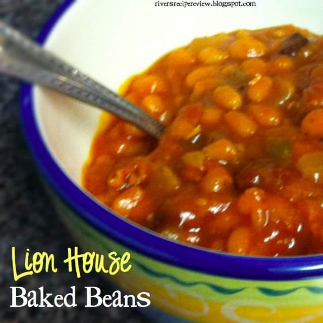 Lion House Baked Beans in a festive bowl with a metal spoon.