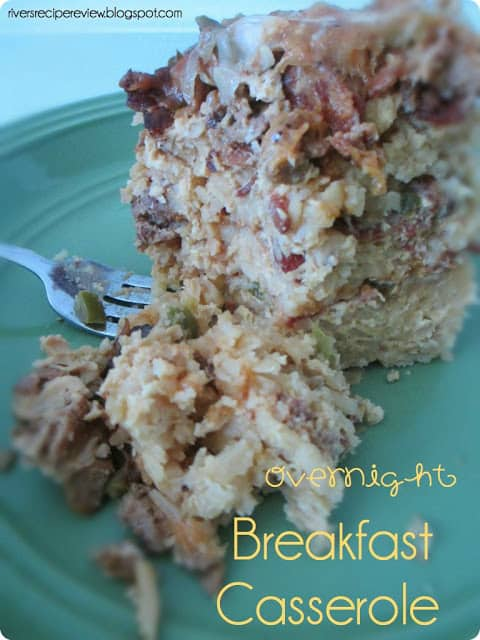 Overnight Breakfast Casserole on a blue plate with a metal fork.