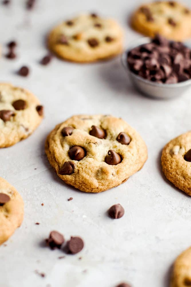 Pudding cookies on a table with chocolate chips.