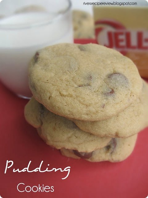 Pudding cookies stacked with a glass of milk