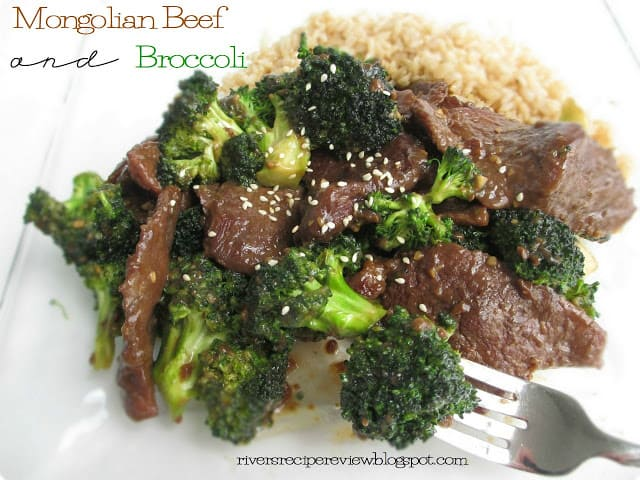 Mongolian Beef and Broccoli with brown rice on a white plate with a metal fork.