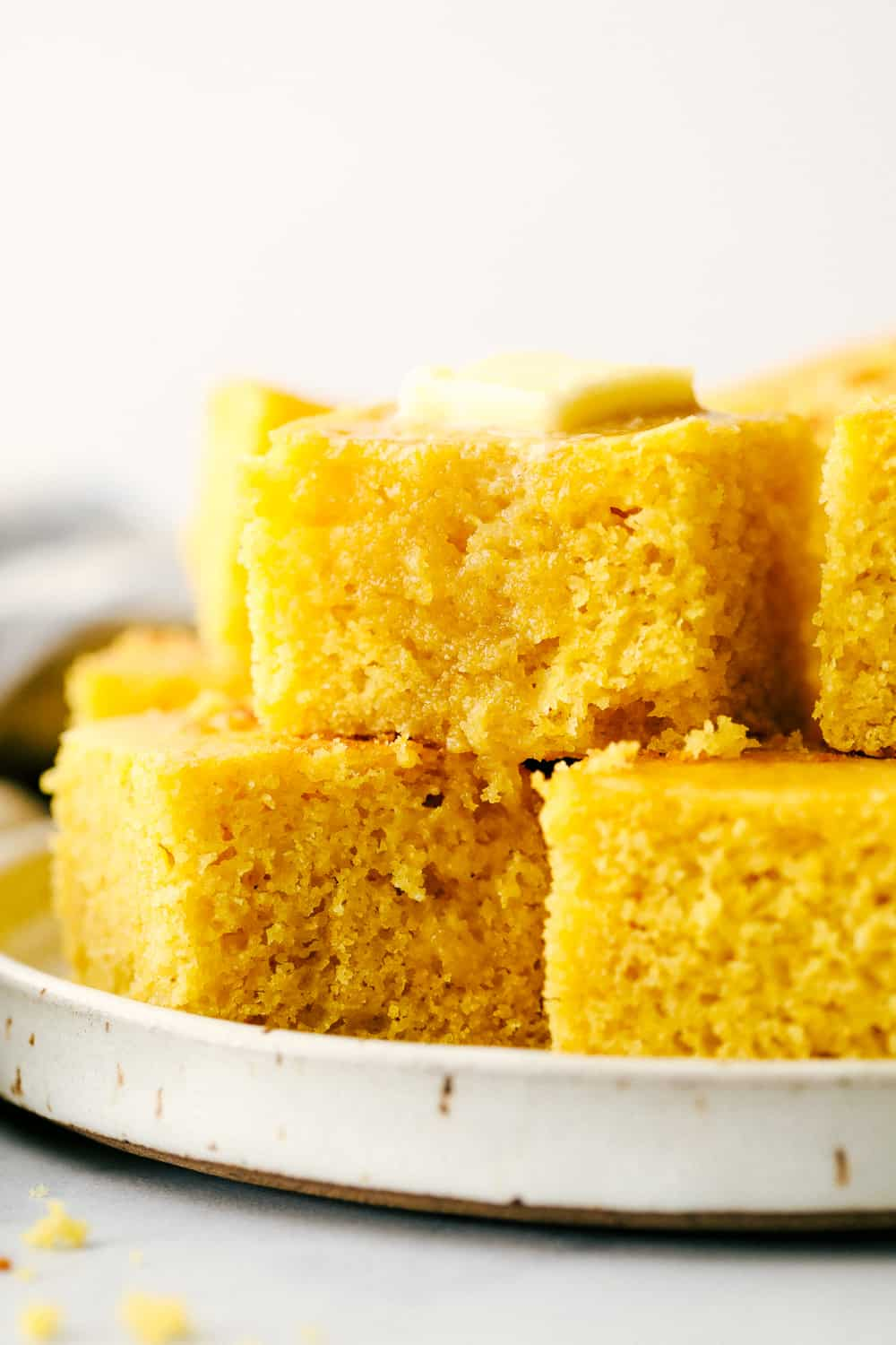 Close up on stack of slices of cornbread.