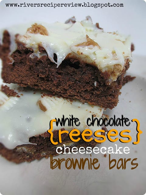 White Chocolate Reeses Cheesecake Brownie Bars stacked on one another.