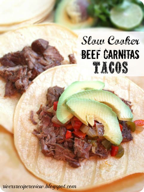 Slow cooker beef carnitas tacos with avocado slices.