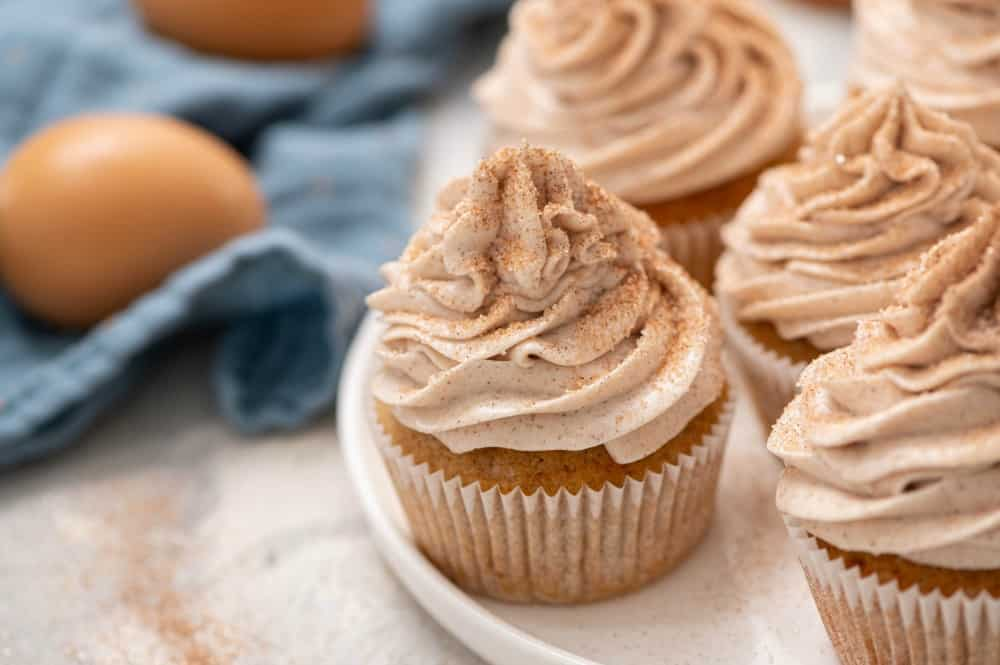 Churro cupcakes on a white plate.