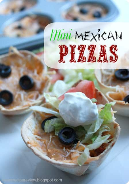 Mini Mexican pizzas garnished with sour cream, olives and tomatoes.