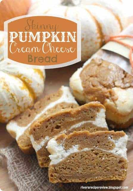 Skinny pumpkin cream cheese bread sliced into one inch slices with white pumpkins all around.