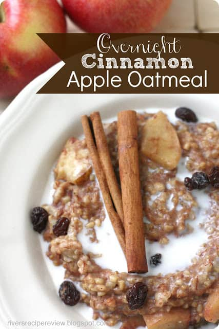 Overnight cinnamon apple oatmeal in a white dish with cinnamon sticks on top.