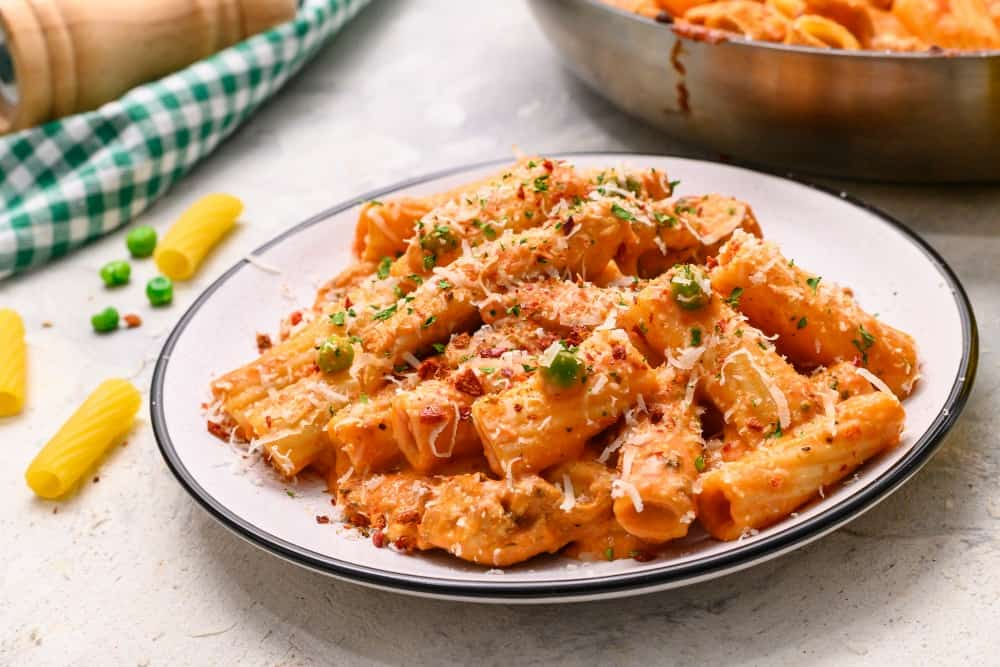 Spicy chicken rigatoni on a white plate.