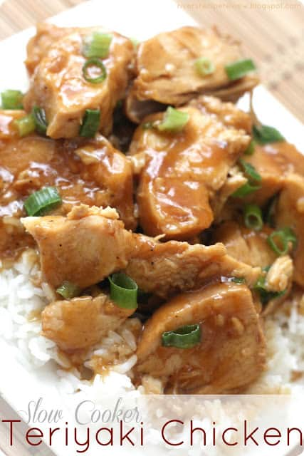 Slow cooker teriyaki chicken served over rice garnished with scallions.