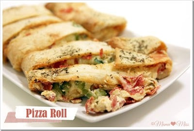 Pizza rolls on a white rectangular plate.