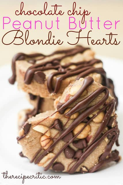 Four chocolate chip peanut butter blondie hearts drizzled in chocolate.