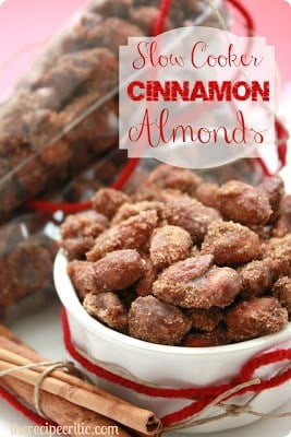 Slow cooker cinnamon almonds in a white bowl.