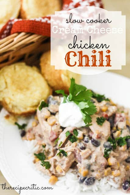Slow Cooker Cream Cheese Chicken Chili over rice on a white plate