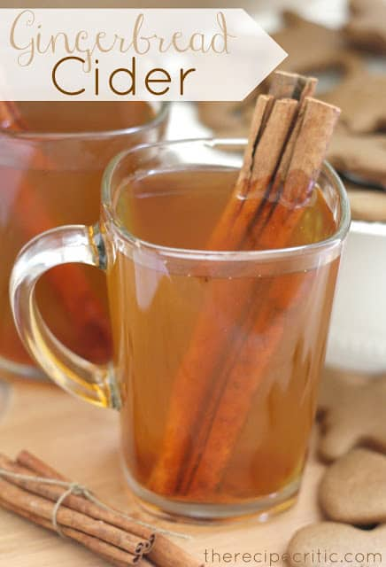 Gingerbread Cider in two clear glass mugs with 3 cinnamon sticks in one of the mugs.