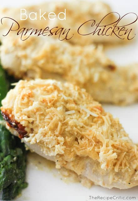 Three pieces of baked parmesan chicken resting on a white plate.