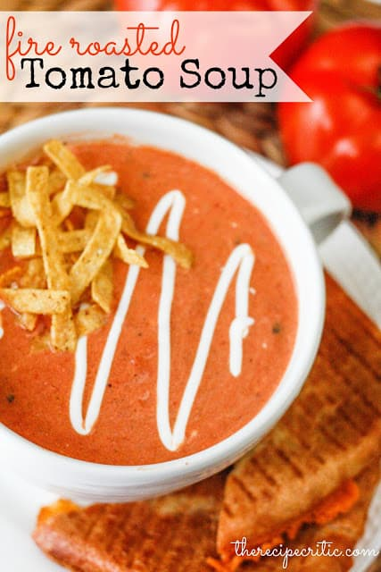 Fire Roasted Tomato Soup in white cup with tortilla chips on top