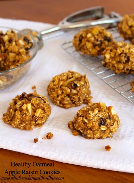 Healthy oatmeal apple raisin cookies on cooling sheet