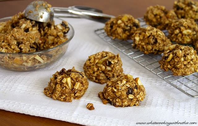 Healthy Oatmeal Apple Raisin Cookies on cooling sheet and in a glass bowl.