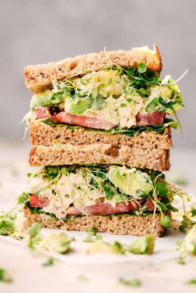 Avocado Chicken Salad sandwich cut in half and stacked.