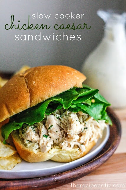 Slow Cooker Chicken Caesar Sandwich on white plate with chips