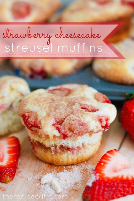 Strawberry cheesecake streusel muffin on a wooden table.