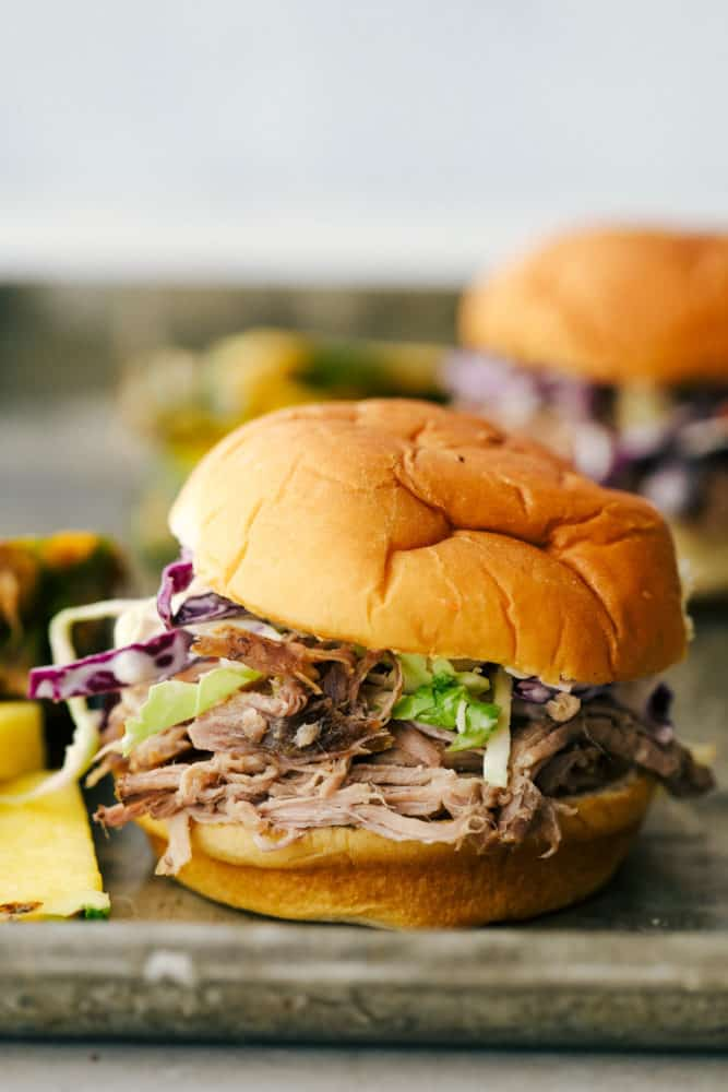 Slow Cooker Kalua Pulled Pork, tender smokey and moist, served on a bun.