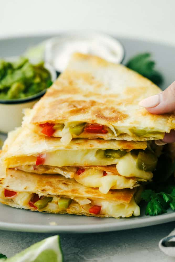 Fajita Style Quesadillas are sauted peppers and onions with melted cheese in a crisp tortilla.