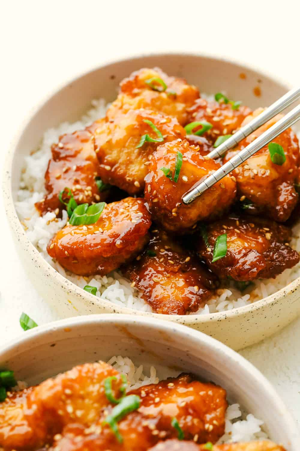 Juicy, tender Baked Sweet and Sour Chicken on top of rice.