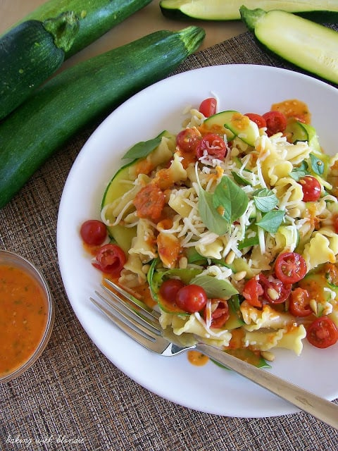 Garden Campanelle Salad with Fresh Tomato Basil Dressing on a white plate.
