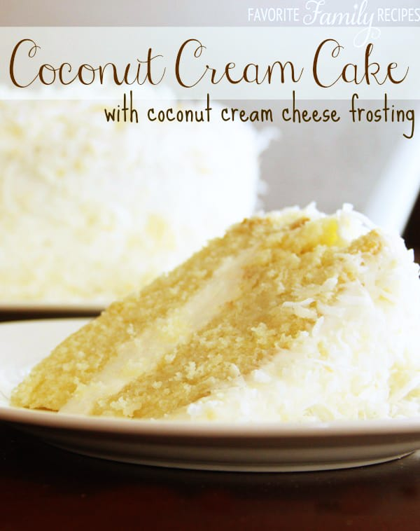 Slice of coconut Cream Cake with coconut cream cheese frosting on a white plate.