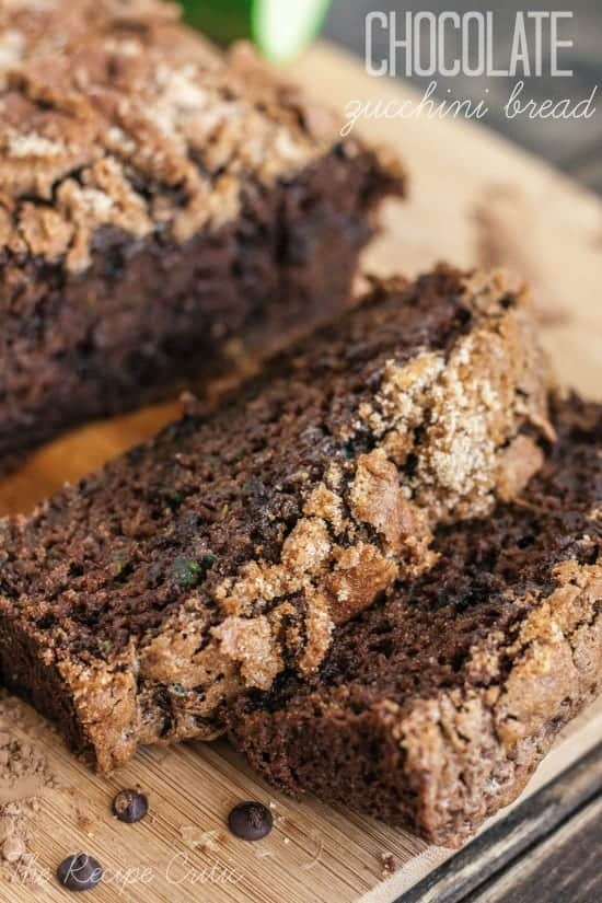 Chocolate zucchini bread sliced on a wooden counter.