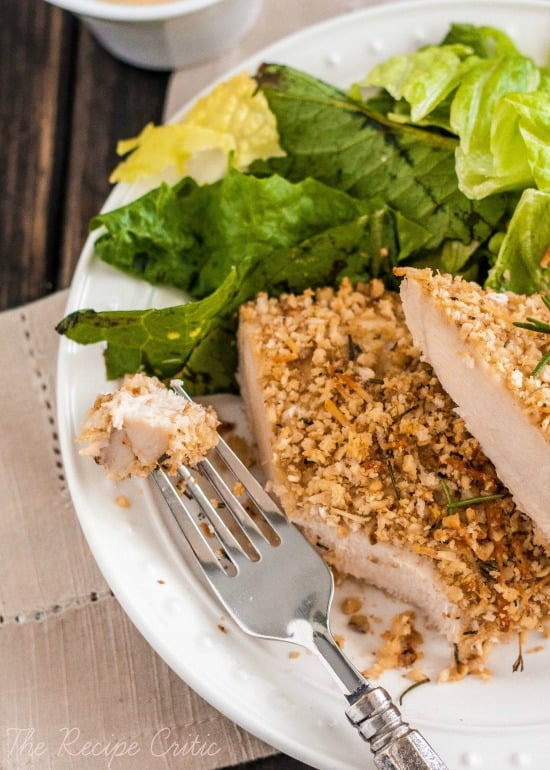 Walnut crusted chicken sliced on a white plate.