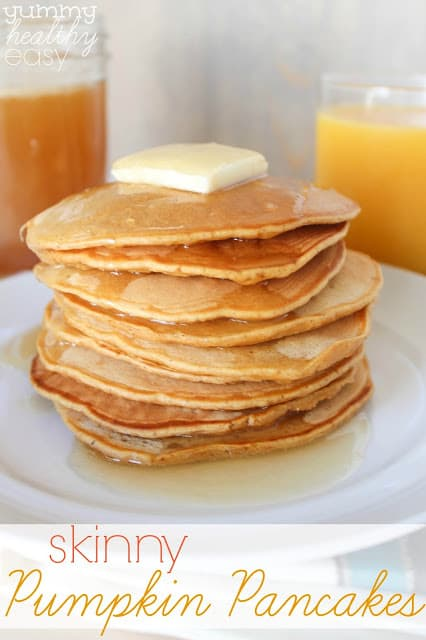 Stack of skinny pumpkin pancakes in a stack on a white plate.