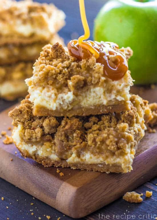 Caramel apple cheesecake bar with a drizzle of caramel sauce.