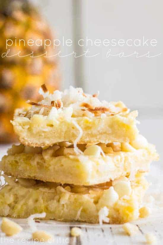 Pineapple cheesecke dessert bars in a stack.