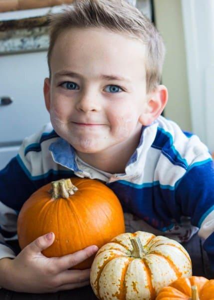 Luke holding pumpkins.