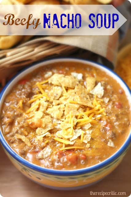 Beefy nacho soup in a blue and white bowl.