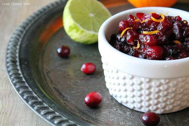 Orange and Lime Cranberry Sauce in a small white cup.