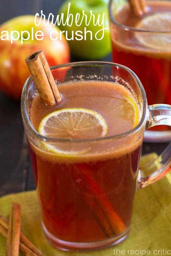 Cranberry apple crush in a glass mug with a cinnamon stick.
