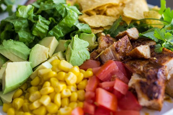 Close up photo of the ingredients of chicken taco salad.