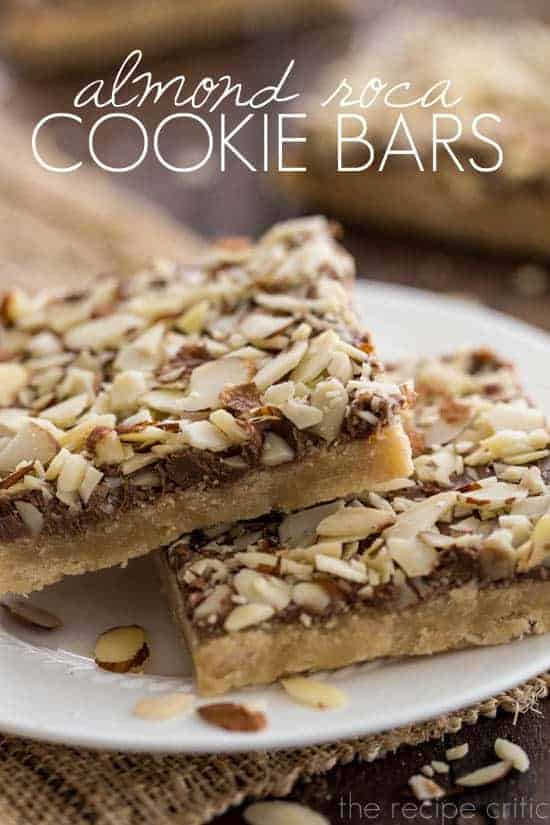 Almond Roca Cookie Bars that have been sliced and place on a white plate.