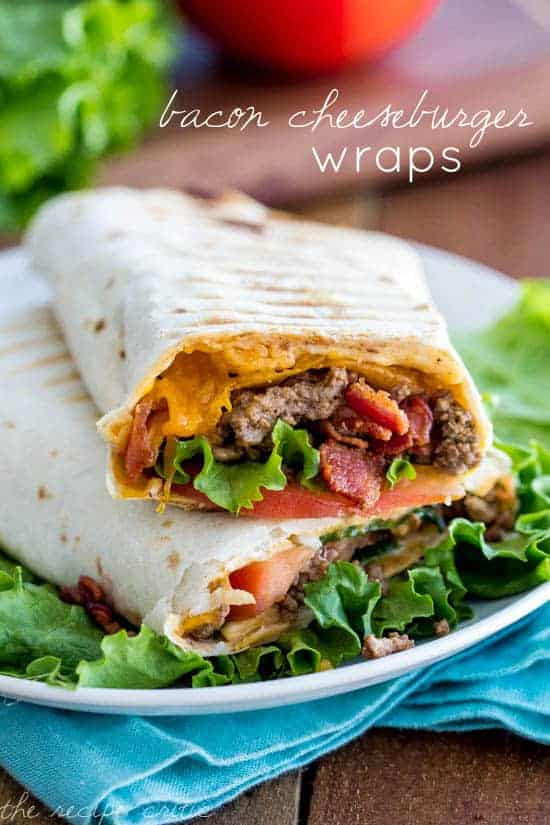 Bacon Cheeseburger Wraps on a white plate with a blue table towel under it.