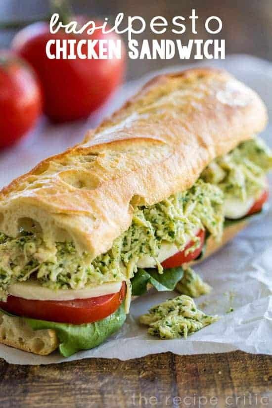 Basil Pesto Chicken Sandwich with whole tomatoes in the background.