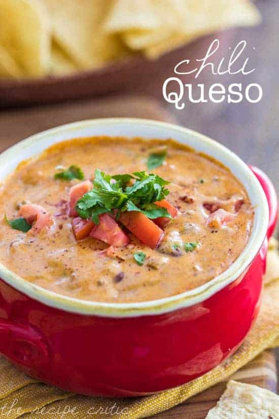 Chili Queso in a red serving dish.