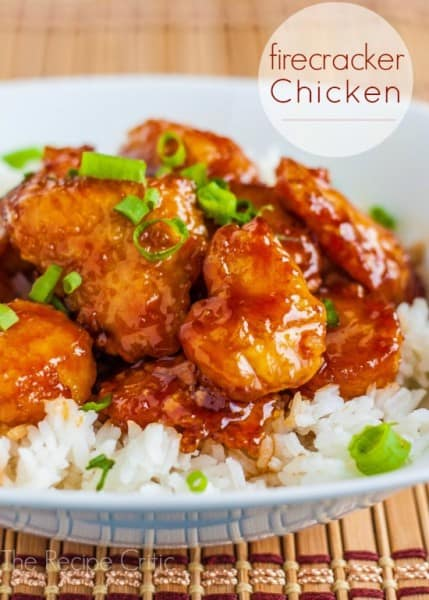 Firecracker Chicken over white rice on a white bowl.