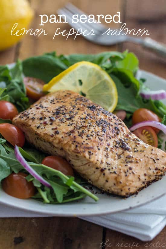 Pan Seared Lemon Pepper Salmon with salad on a white plate.