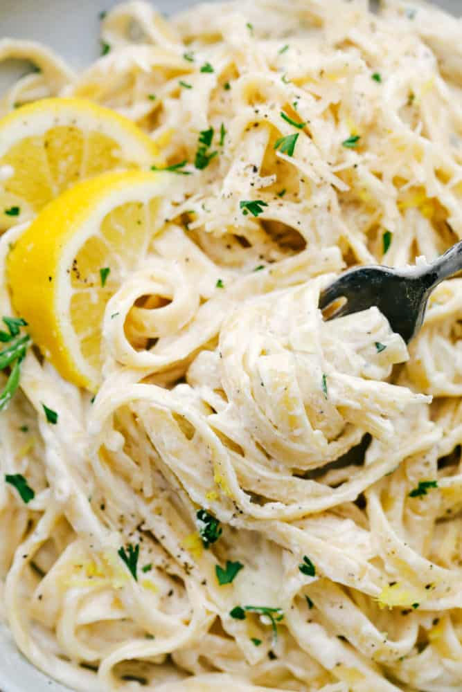 Close up of Lemon Garlic Cream Fettuccini with a fork removing some.