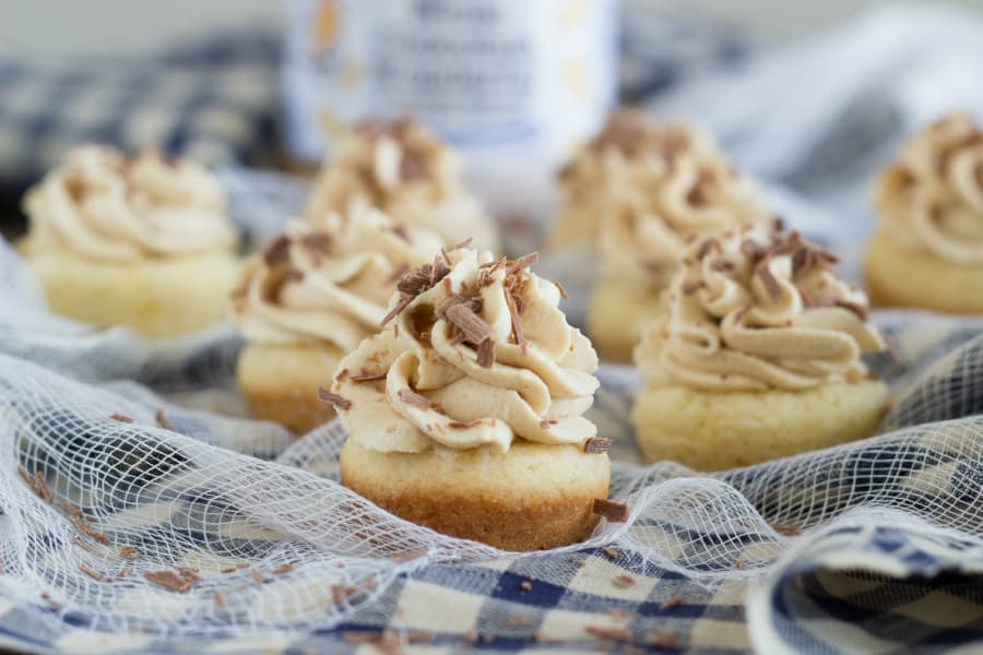 Miniature sugar cookie cups that are filled with a peanut butter mousse and garnished with chocolate shavings