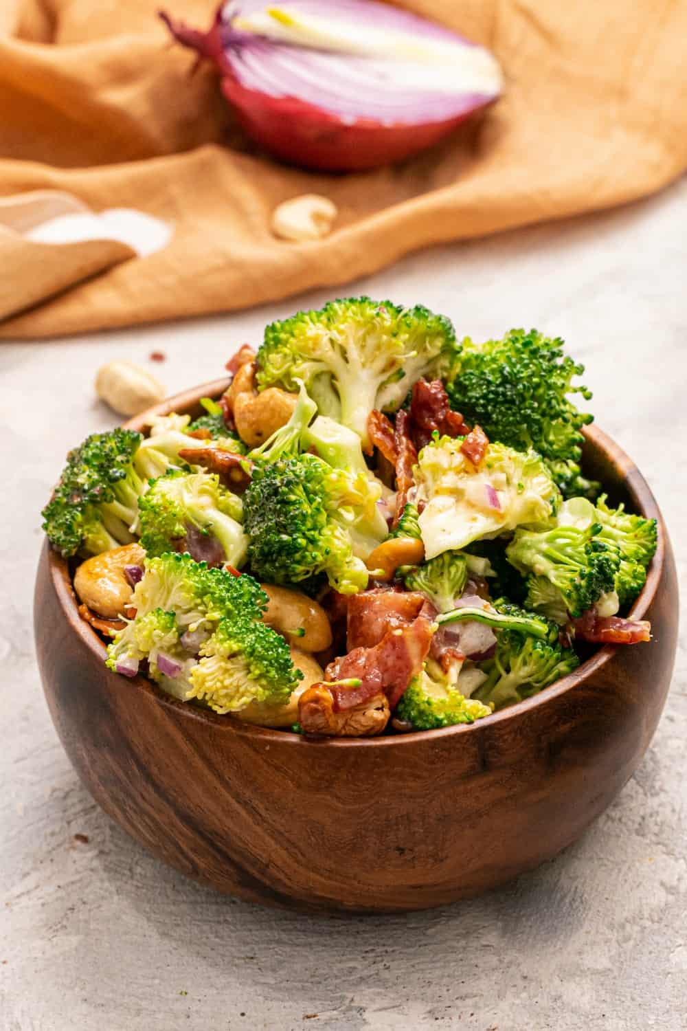 Cashew Broccoli Salad in a wooden bowl.